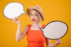 Doubting the choice emotions woman in straw hat and red fancy dress is holding speech buble banners. Yellow background. Doubting the choice confused emotions royalty free stock images