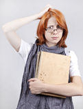 Doubting fashion girl in glasses with old book Stock Images