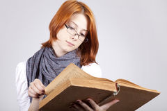 Doubting girl in glasses with old book Royalty Free Stock Photos