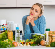 Doubting girl thinking what to cook for dinner Royalty Free Stock Photography