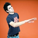 Doubting male. Doubting male making a gesture of being wary. Portrait orientation royalty free stock images