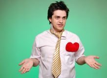Doubting men with tie and heart. Stock Image