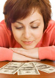 Doubting young woman with money isolated Stock Image