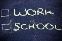 Doubts: choice between work and school Royalty Free Stock Photos