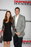 Doug Savant, Laura Leighton. LOS ANGELES - SEPT 21:  Laura Leighton, Doug Savant arriving at the Desperate Housewives Final Season Kick-Off Party at Wisteria Royalty Free Stock Images