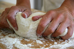 Dough. Woman's hand working the dough Royalty Free Stock Photo