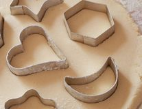 Dough. Nice cookie cutters on dough stock photography