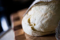 Dough. Photo of dough on wooden board stock image