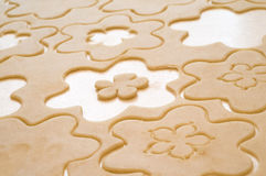 Dough. With cuted figures, flowers, flour on the table Stock Photo