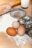 Dough baking ingredients, eggs, flour, milk and retro biscuit cutter Stock Images