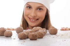 Dough balls and woman chef cook Royalty Free Stock Photos