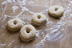 Dough being prepared to make donuts stock image