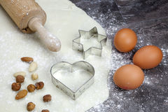 Dough for biscuits. A rolled out dough for biscuits with flour Royalty Free Stock Images