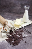 Dough for biscuits. A rolled out dough to bake biscuits with different ingredients Royalty Free Stock Images