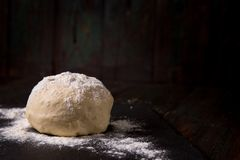 Dough on a black board royalty free stock photography