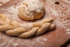 Dough braid on flour Stock Photography