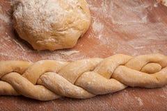 Dough braid on flour Stock Photos