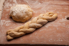 Dough braid on flour Royalty Free Stock Photography