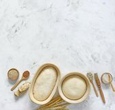 Dough for bread on leaven, yeast, in baskets for proofing dough. The dough for sourdough bread, the yeast in baskets made of rattan for proofing dough Stock Photos