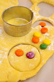 Dough with candies. Fresh made dough with color candies Stock Photography