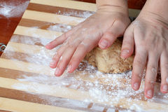 Dough in chef's hands Stock Image