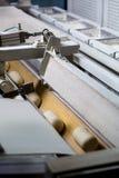 Dough on the conveyor. Stock Photo
