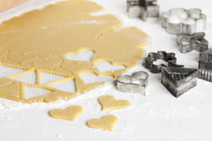 Dough with cookie cutters Stock Image