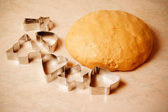 Dough for  cookies and cookie cutters Stock Photos