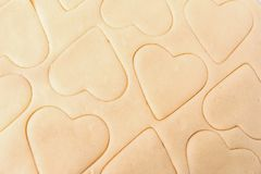 Dough for cookies. A mold for cutting cookies in the form of heart. St. Valentines Day. Top view royalty free stock images