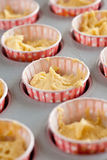 Dough in cupcake tins Stock Photo