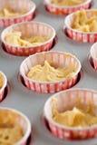 Dough in cupcake tins Stock Photo