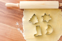 Dough with cutting forms Royalty Free Stock Image