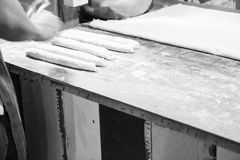 Dough of deep-fried doughstick  on wooden table Stock Photo