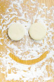 Dough for donuts that smile Stock Photos