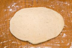 Dough Flat. The dough has been rolled flat Royalty Free Stock Images