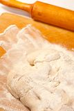 Dough in flour Royalty Free Stock Images