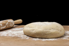 Dough on flour covered board. Royalty Free Stock Photography