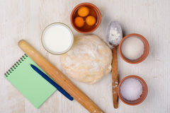 Dough, flour, eggs, milk, salt, sugar, baking ingredients Royalty Free Stock Images