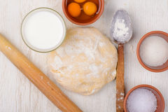 Dough flour, eggs, milk, salt, sugar, baking ingredients Stock Photo