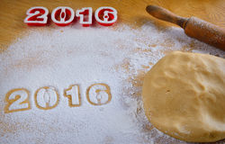 Dough, flour and rolling pin on wooden table with numbers 2016 Stock Photo