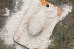 Dough in flour for rye bread on a wooden board royalty free stock photography