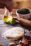 Dough with flour on wooden table, preparing homemade pizza Royalty Free Stock Images