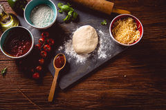 Dough with flour on wooden table, preparing homemade pizza Royalty Free Stock Photography