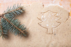 Dough for gingerbread cookie and cookie cutted in christmas tree Royalty Free Stock Images