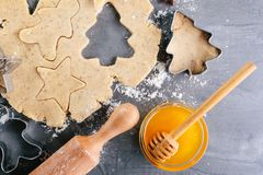 Dough and ingredients for ginger cookies. Time for Christmas baking. Culinary background, top view Royalty Free Stock Photos