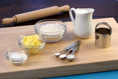 Dough ingredients and kitchen utensils Stock Image