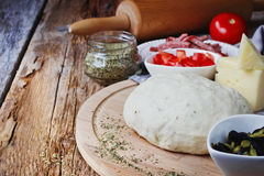 Dough and ingredients for pizza Stock Photography