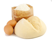 Dough and its components ( flour, eggs) . Royalty Free Stock Photography