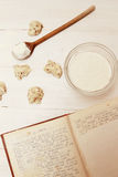 Dough with old cookbook Stock Images
