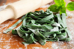 Dough for pasta spinach. Royalty Free Stock Photo